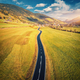 Aerial view of the road in mountain valley at sunset - PhotoDune Item for Sale