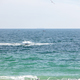 Picturesque seascape with flying birds and boats, soft waves on summer day - PhotoDune Item for Sale