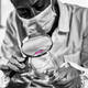 Free Download Forensics. Forensic Expert Examining Crime Scene Evidence. Nulled