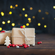 Christmas gifts wrapped in brown paper, bokeh background - PhotoDune Item for Sale