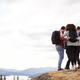 A group of five mixed race young adult friends embrace after arriving at the summit  - PhotoDune Item for Sale