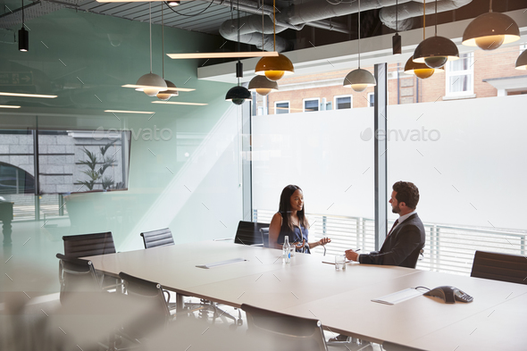 Businessman Interviewing Female Candidate At Graduate Recruitment Assessment Day In Office - Stock Photo - Images