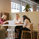 Group Of Young Businesswomen Sitting Around Table And Collaborating  - PhotoDune Item for Sale