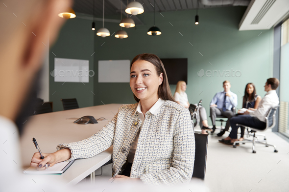 Businesswoman And Businessman Collaborating On Task Together At Graduate Recruitment Assessment Day - Stock Photo - Images