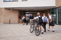 Group Of High School Students Wearing Uniform Arriving At School  - PhotoDune Item for Sale
