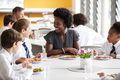 Female Teacher With Group Of High School Students In Cafeteria - PhotoDune Item for Sale