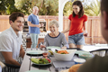 Parents and adult children having a barbecue in the garden - PhotoDune Item for Sale