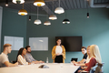 Businesswoman Addressing Group Of Candidates Meeting Around Table  - PhotoDune Item for Sale