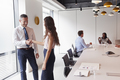 Businessman And Businesswoman Shaking Hands In Modern Boardroom  - PhotoDune Item for Sale