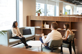 Businessman And Businesswoman Interviewing Female Candidate In Office  - PhotoDune Item for Sale