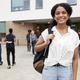 Portrait Of Smiling Female High School Student Outside College Building  - PhotoDune Item for Sale