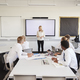Female High School Teacher Standing Next To Interactive Whiteboard  - PhotoDune Item for Sale