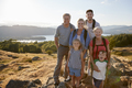 Portrait Of Multi Generation Family Standing At Top Of Hill On Hike Through Countryside  - PhotoDune Item for Sale