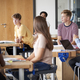 Free Download Group Of High School Students Sitting At Work Benches Having Discussion Nulled