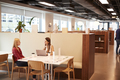 Two Young Businesswomen Having Informal Interview In Cafeteria Area  - PhotoDune Item for Sale