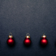 Christmas balls flat layout on dark background. - PhotoDune Item for Sale