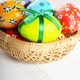 Rustic style painted easter eggs in basket on white table - PhotoDune Item for Sale
