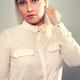 Beautiful female blonde model in shirt holding her hair - PhotoDune Item for Sale