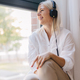 Woman listening to music, looking through the window. - PhotoDune Item for Sale