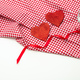 Valentines day. Red hearts on  red checkered table cloth, white background, copy space, top view. - PhotoDune Item for Sale