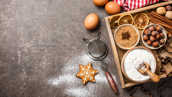 Christmas background. Table for holiday baking cookies with ingredients - Stock Photo - Images