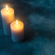 Two burning candles on navy blue background - PhotoDune Item for Sale