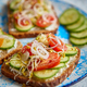 Free Download Plate with toasts with cucomber, tomatoes and crumbled feta and radish sprouts Nulled