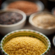 Free Download Raw couscous seeds in ceramic bowl. Selective focus Nulled