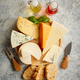 Free Download Various types of cheese served on rustic wooden board Nulled