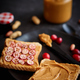 Free Download Toasts bread with homemade peanut butter served with fresh slices of cranberries Nulled