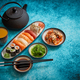 Free Download Asian food assortment. Various sushi rolls placed on ceramic plates Nulled