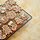Free Download Fresh baked Christmas shaped gingerbread cookies placed on steel grill Nulled