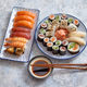 Asian food assortment. Various sushi rolls placed on ceramic plates - PhotoDune Item for Sale