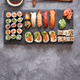 Free Download Composition of different kinds of sushi rolls placed on black stone board Nulled