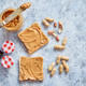 Two tasty peanut butter toasts placed on stone table - PhotoDune Item for Sale