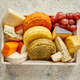 Fresh and delicious different kinds of cheeses placed in wooden crate with grapes - PhotoDune Item for Sale