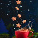 Free Download Star-shaped cookie Ursa Minor constellation with chocolate crumbs over a red cup of Christmas hot Nulled