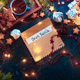 Free Download Letters to Santa concept, Christmas flat lay with fairy lights, star-shaped cookies, and tea Nulled