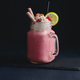 Free Download Cold strawberry milkshake in a vintage glass mason jar. Dark background with copy space for a menu Nulled