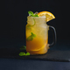 Free Download Ice cold citrus cocktail in a vintage glass mason jar. Dark background with copy space for a menu Nulled