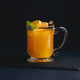 Fruit punch in a glass cup on a dark background with copy space for a menu. Orange, sea buckthorn or - PhotoDune Item for Sale