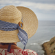 Summer time. Woman with hat and blue background. Relaxing time - PhotoDune Item for Sale