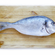 Gilthead fish over a wooden table. Healthy and fresh cuisine - PhotoDune Item for Sale