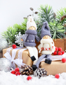 Christmas composition with toys dolls and spruce branches and fe - PhotoDune Item for Sale