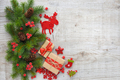 Christmas decorations and spruce branches on a wooden background - PhotoDune Item for Sale
