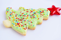 Gingerbread in the form of a christmas tree on a white backgroun - PhotoDune Item for Sale