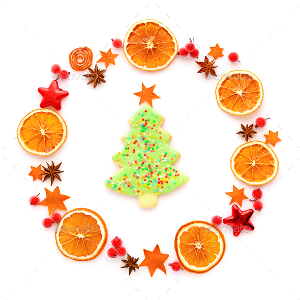 Round frame with dried orange, christmas cookies, anise stars on - Stock Photo - Images
