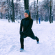 Female athlete exercising in park in winter - PhotoDune Item for Sale