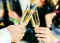 Celebration. Hands holding the glasses of champagne and wine making a toast. - PhotoDune Item for Sale