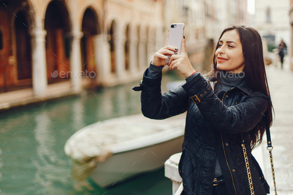 girl talking on the phone and taking pictures in Venice - Stock Photo - Images